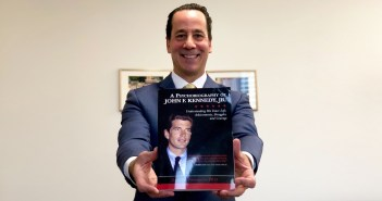 Ponterotto holds a copy of his new book.