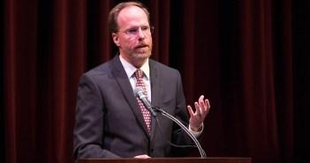Dennis C. Jacobs speaks at a podium