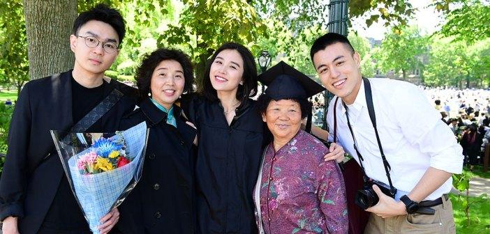 Graduate posing with four family members