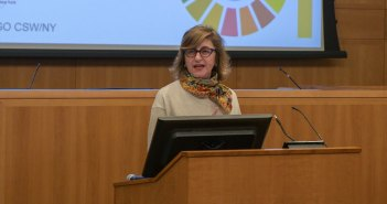 A woman talks at a podium