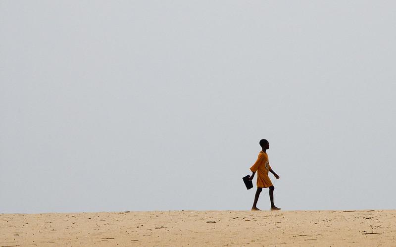 Girl walking to school, Ghana