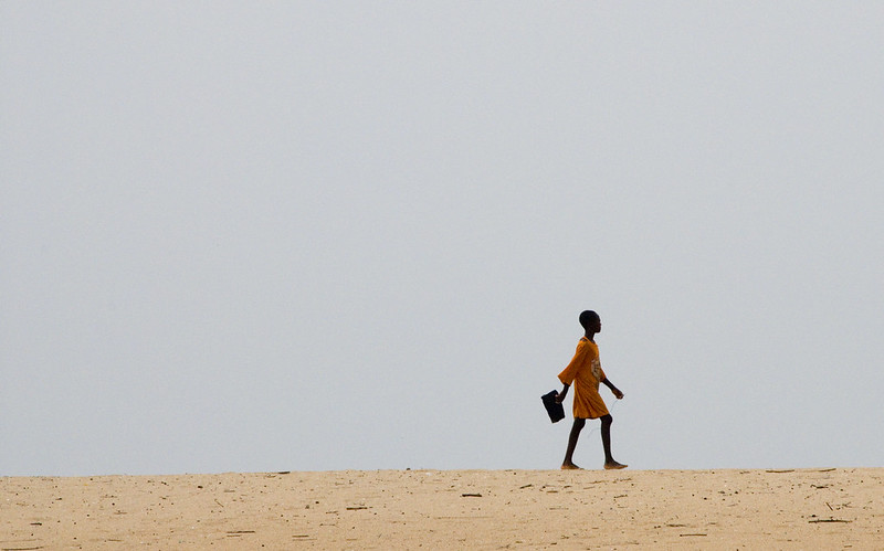 Girl walking to school, Ghana
