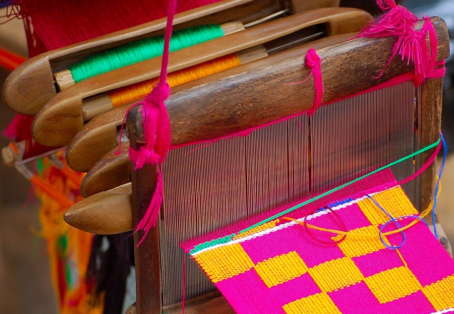 Ghanaian kente fabrics are woven of silk and cotton in rich colors. Lee D. Baker, Flickr