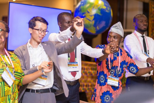 Participants join hands at the AsaseFest, a series of workshops and focus-group discussions. Musah Botchway, Global Landscapes Forum