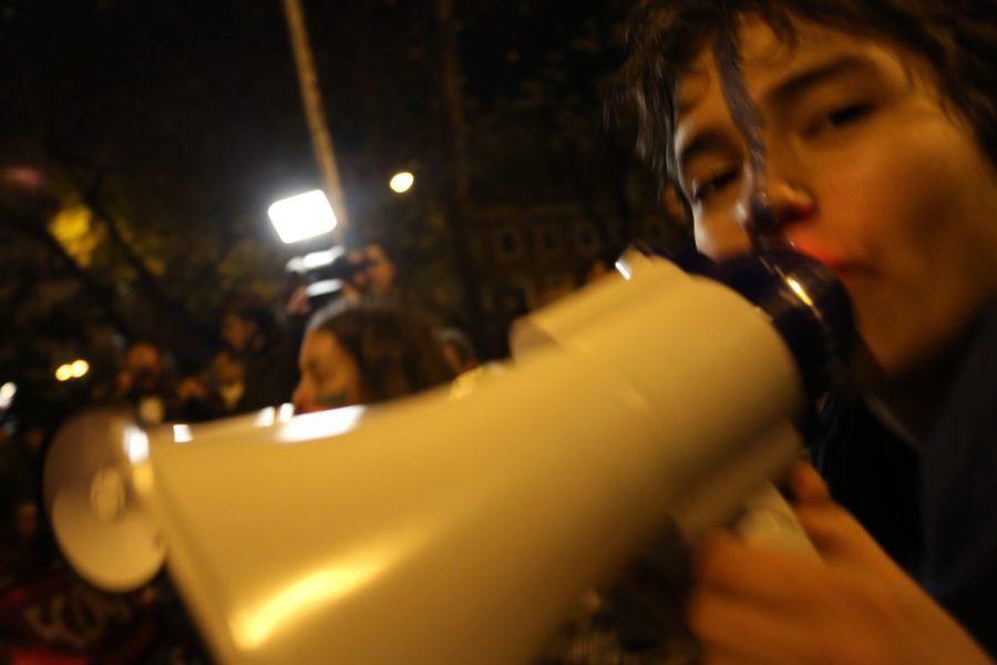 An activist shouts into a megaphone. Melissa Kaye Angel, GLF