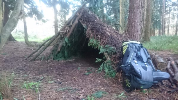 Shelter made from forest materials layered for waterproofing is the first skill learned in bushcraft. David Charles