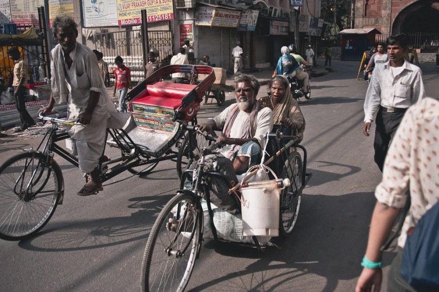 Bike riders in New Delhi. Elliott Scott, Flickr