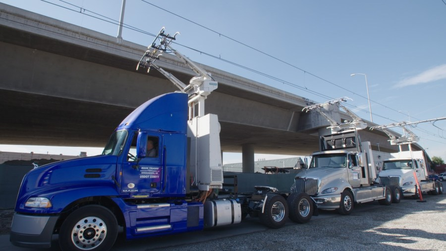Trucks are hooked up to cables on ehighways in California. Courtesy of Siemans