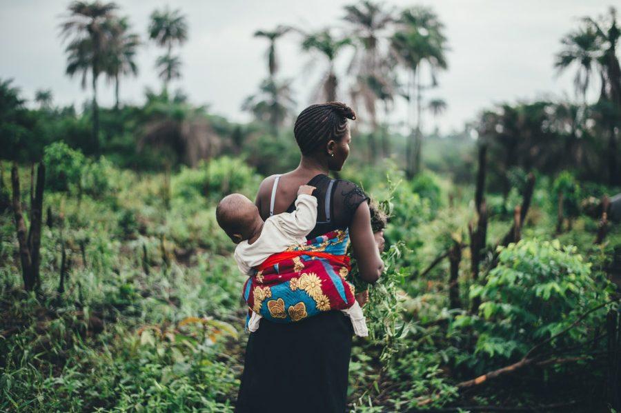 A woman and child in a forest in Sierra Leone. anniespratt, Unsplash