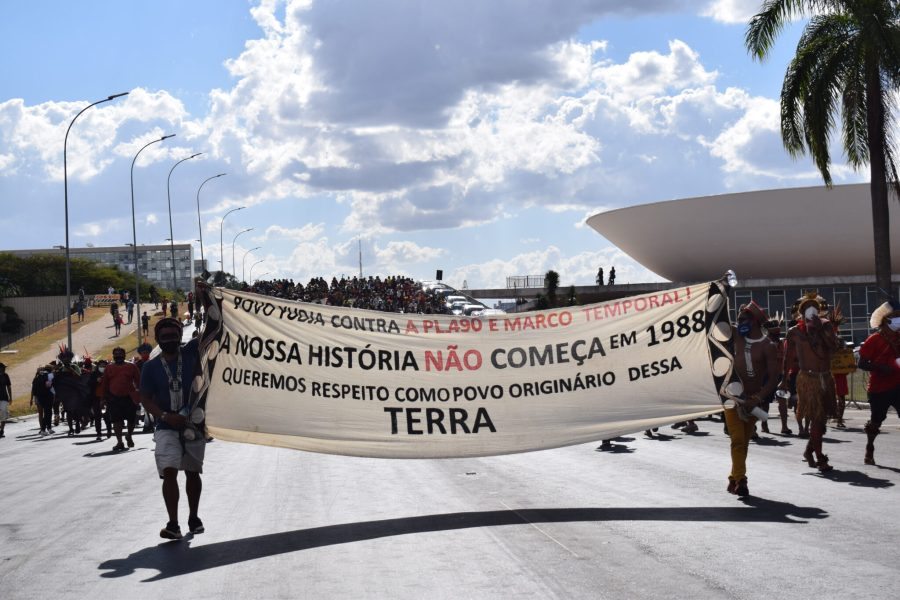 """""""Our history doesn't start at 1988. We want respect as the original people of this land,"""" reads a sign at the demonstrations. Martha Fellows, Global Landscapes Forum"""