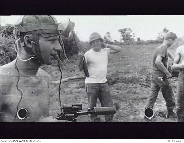 Australian combat engineer assisting American forces in Vietnam with tunnel clearing operations Vietnam Phuoc Tuy Province 1966 note S&W Smith Wesson suppressed revolver AWM P01595.021