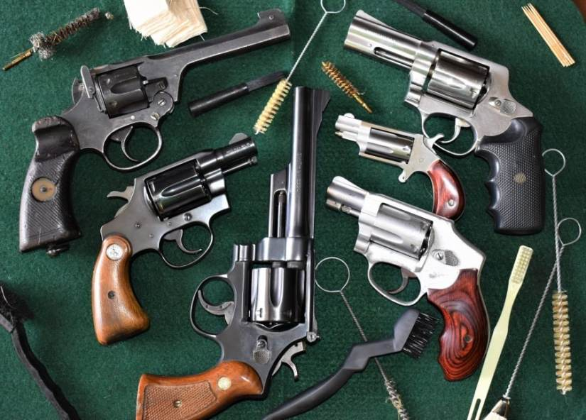 This cross section of wheel guns covers five manufacturers across three continents and includes a little bit of everything-- but they can all generally be cleaned the same. The spread includes a WWII British Enfield No.2 Mk I* in .38/200, a Colt Detective Special, Smith & Wesson Model 28 Highway Patrol in .357 Magnum, S&W 642 Airweight, a single-action North American Arms .22WMR Mini Revolver, and a DAO 1970s Rossi M720 .44 Special. (All photos: Chris Eger/Guns.com)