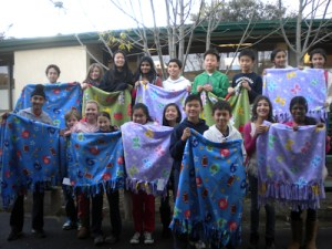 Middle School Students Make Blankets for Children in Need