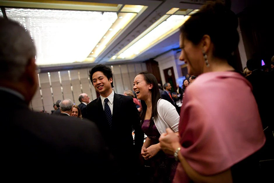 Phillip Zhang '12 (left) and Yi Cai '11 speak with guests following the duet they performed during the banquet.  Stephanie Mitchell/Harvard Staff Photographer