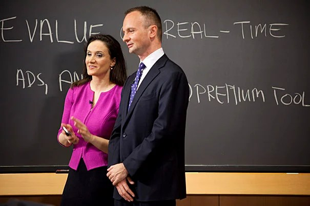 """CNBC """"Power Lunch"""" visits Harvard Business School to create several live segments on Twitter's business plan with student and faculty experts in Hawes Hall. Michelle Caruso-Cabrera (left) reports the show and HBS associate professor Mikolaj Jan Piskorski provides expert advice."""
