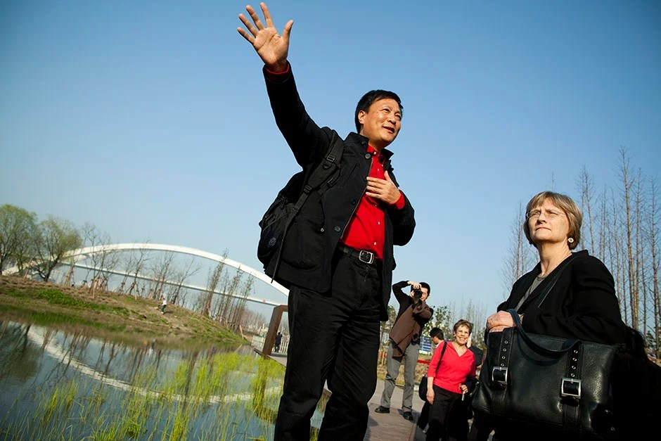 Faust tours the architectural sights of Shanghai, including the World Expo site. Kongjian Yu (from left) speaks with Faust as he leads the walking tour along the World Expo site. Stephanie Mitchell/Harvard Staff Photographer