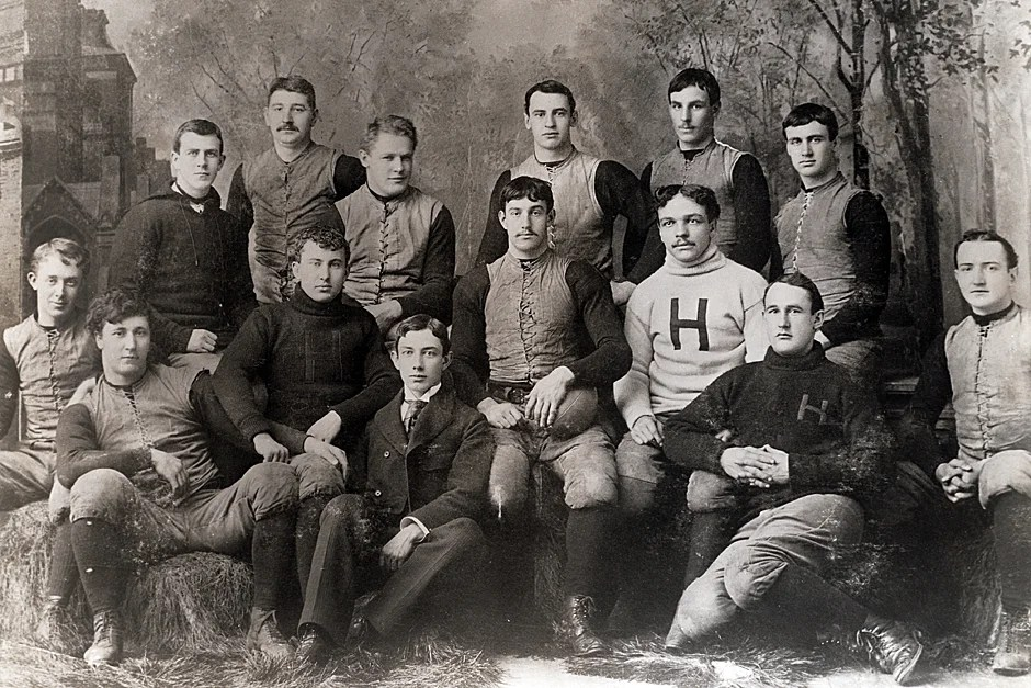 William H. Lewis, LL.B. 1895, was the first African American named to a College Football All-America Team. He was the first African American to be honored as an All-American. Lewis was hired as a football coach at Harvard, where he served from 1895 to 1906. This Varsity Football Team fall season photograph shows Lewis (third from right, seated) in 1892. Credit: Harvard University Archives, call # UAV 170.270.2 PF