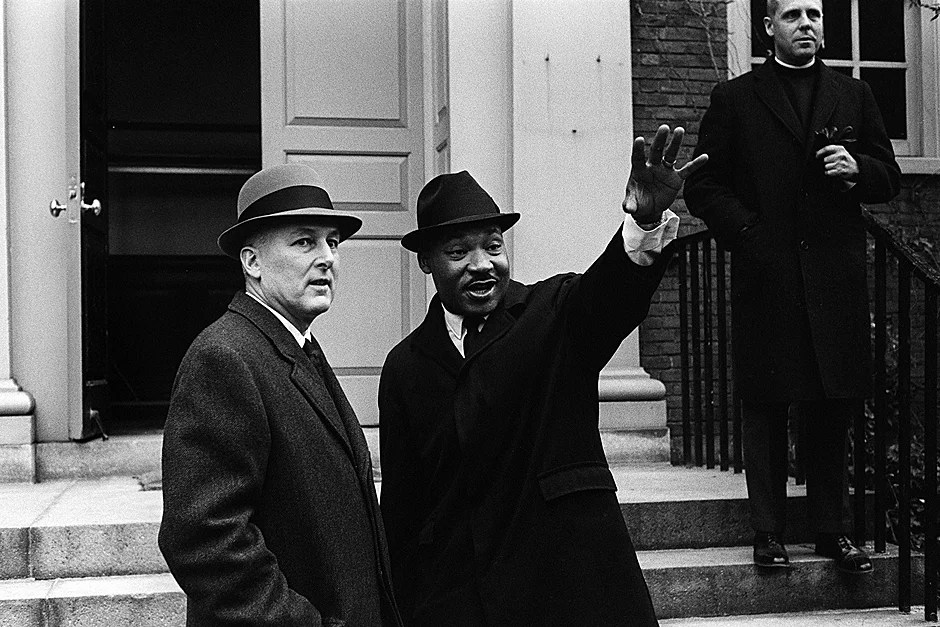 President Nathan Pusey with the Rev. Martin Luther King Jr. on the steps of Appleton Chapel during a Southern Christian Leadership Conference meeting on Jan. 10, 1965. Also pictured is the Rev. Charles P. Price (upper right). Credit: Harvard University Archives, call # UAV 605 Box 86