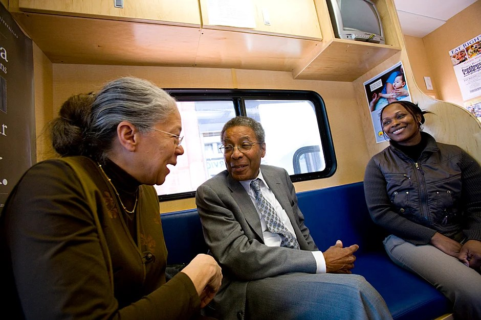 April 24, 2009. The Family Van travels throughout the city of Boston providing basic medical attention to underserved communities in the metro-Boston area including Dorchester, Hyde Park, Mattapan, and Roxbury. Harvard Medical School's Nancy Oriol (from left) and Alvin Poussaint speak to Sandra Moreno, who translates for clients from Cape Verde and works for WIC. Photo by Stephanie Mitchell/Harvard Staff Photographer
