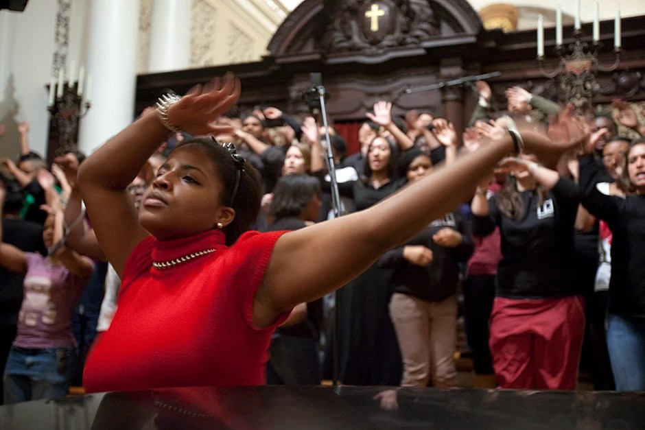 """Dec. 4, 2009. Amber James '11 rehearses for the Kuumba Singers of Harvard College winter concert inside the Memorial Church: """"The songs we sing and the dances we do and the poems we read, they are all designed to bring people together in celebration of black creativity and spirituality. The concert is so moving because of the range of emotions that are represented in music from the black diaspora. Pain, sorrow, strength, resilience, peace, joy, love, and countless others are all intensely felt through the music and movements."""" Photo by Kris Snibbe/Harvard Staff Photographer"""