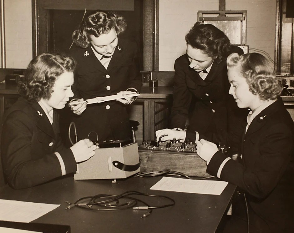"Harvard University Archives image. Inscription reads, ""Navy, L to R, Ensigns E. Schwerin, Norma Meyer, Olga Quadland, and Edith Paulsen, Engineering 263-5 Course at Pierce Hall, October 23, 1943."" Stephanie Mitchell/Harvard Staff Photographer"