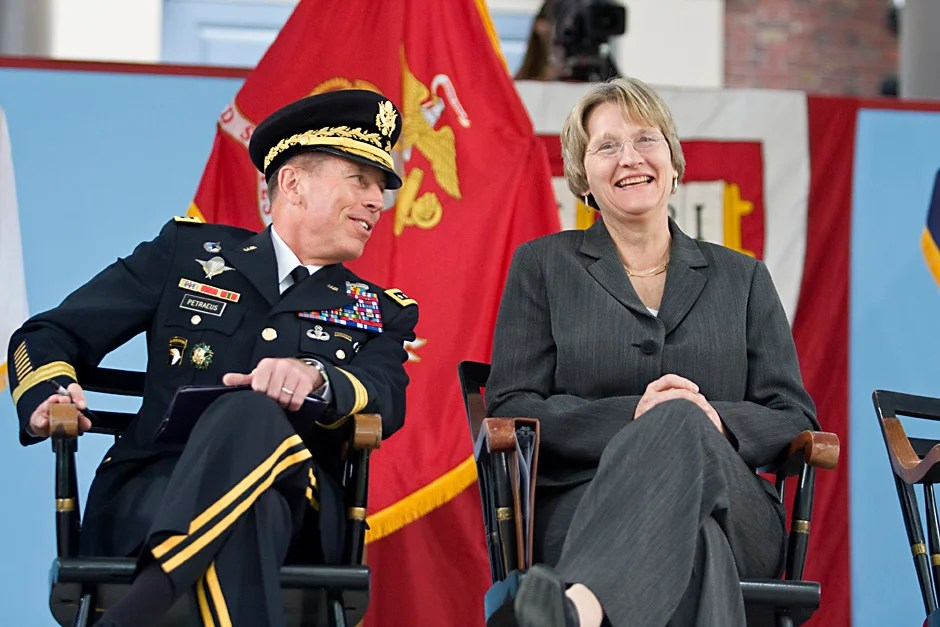 Gen. David H. Petraeus and Harvard President Drew G. Faust share a laugh during the 2009 ROTC commissioning ceremony. Jon Chase/Harvard Staff Photographer