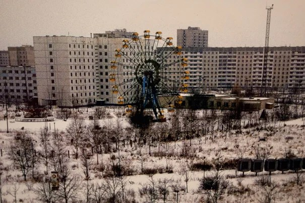 "Twenty-five years later, Chernobyl remains a deserted city in northern Ukraine. Nearby, 350,000 people were evacuated, including 50,000 from Prypiat, a workers' city a few kilometers away. To this day, it is a spooky ghost town, whose abandoned ferris wheel has become an iconic image of sudden disaster. ""The Day the Ferris Wheel Stood Still"" by Tania D'Avignon is among the images on exhibit at the Knafel Building's Fischer Commons through Aug. 12."