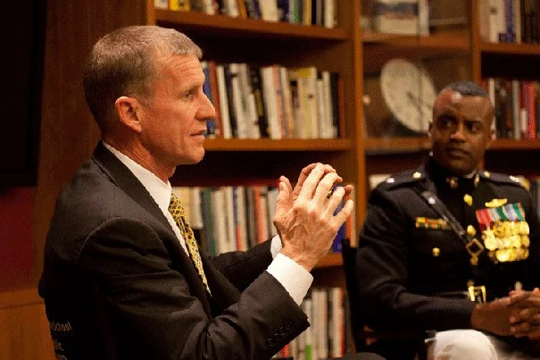 """Gen. Stanley McChrystal (left) and  Lt. Col. Jerry Carter spoke with the National Security Fellows at Harvard. McChrystal was the keynote speaker at an event recognizing Harvard's veterans.  """"I am very proud that President Faust has led the charge for a return of ROTC,"""" he said in his address to the assembled veterans. """"We hope you learn something from us, but we know that you are among our best teachers."""""""