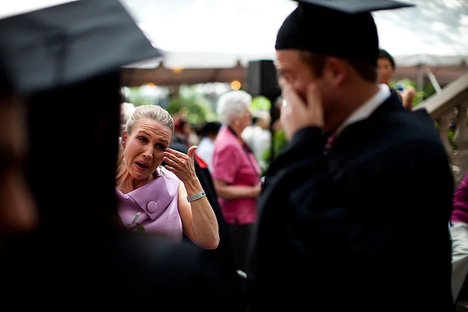 Shelly Mason (left) and her son, Russell Mason, the first Mason to graduate from college, both shed a tear after he receives his diploma at Winthrop House. Stephanie Mitchell/Harvard Staff Photographer