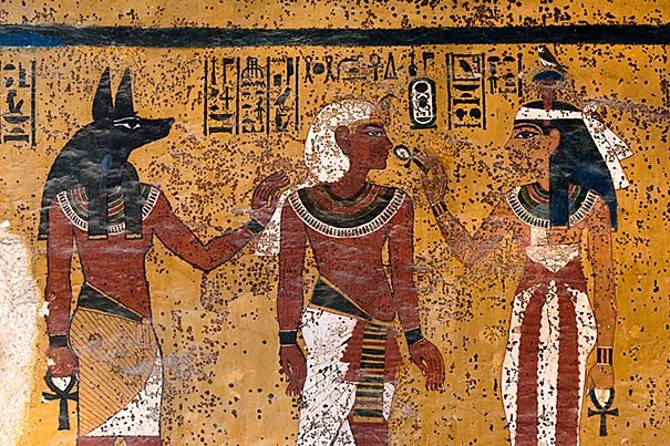 The south wall of Tutankhamen's tomb shows Hathor, goddess of the west, welcoming the pharaoh into the underworld. The embalmer god, Anubis, stands behind the king.