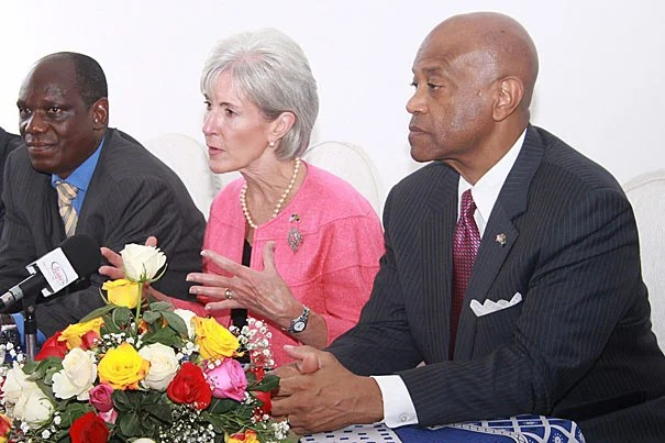 Tanzanian Minister of Health and Social Welfare Haji Mponda (from left),  U.S. Health and Human Services Secretary Kathleen Sebelius, and U.S. Ambassador to the United Republic of Tanzania Alfonso E. Lenhardt joined others at the opening of a new clinic and research center that will benefit Tanzania's sickest AIDS patients.