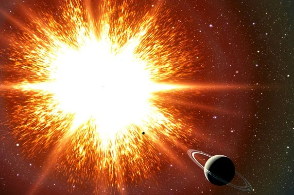 """New research shows that some old stars, known as white dwarfs, might be held up by their rapid spins, and when they slow down, they explode as Type Ia supernovae. Thousands of these """"time bombs"""" could be scattered throughout our Galaxy. In this artist's conception, a supernova explosion is about to obliterate an orbiting Saturn-like planet."""