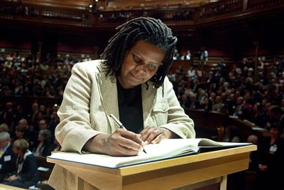 """Among the inductees was Annette Gordon-Reed, pictured signing the book. """"Induction recognizes extraordinary individual achievement and marks a commitment on the part of new members to provide fundamental, nonpartisan knowledge for addressing today's complex challenges,"""" said the academy's President Leslie C. Berlowitz."""