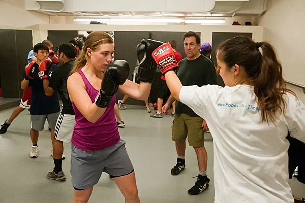 """At practice, women do the same exercises as their male counterparts — 100 reps of sit-ups and push-ups, punching bag drills, and more. """"Forget about the boxing aspect for a moment,"""" said Susan Seav '12 (not pictured). """"A lot of girls join the club just to get a good workout, and to find a buddy who understands the pain."""""""