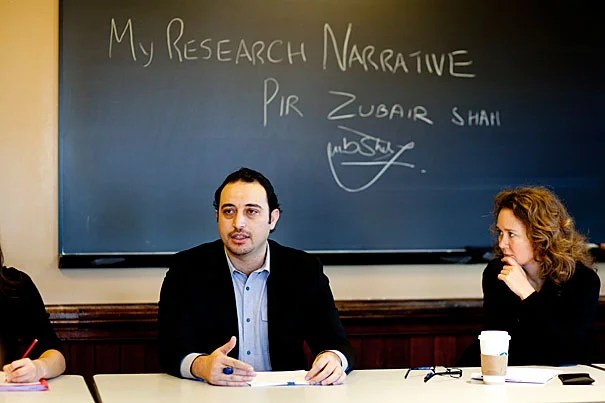 Nieman Fellow and New York Times reporter Pir Zubair Shah speaks at a freshman expository writing class taught by novelist and veteran preceptor Jane Unrue (right). Pir — a Pakistani who grew up in the lawless South Waziristan tribal area — can never again return to his country after his reporting on the Taliban.