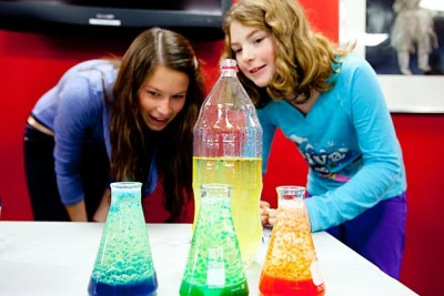 Andrea Henricks '13 (left), a mentor at the Harvard Allston Education Portal, and 10-year-old Nora Lyons made lava lamps, which they presented at a Student Showcase and Open House. The Harvard mentoring program pairs Allston-Brighton children in grades one to 12 with Harvard undergraduates in weekly sessions throughout the semester.