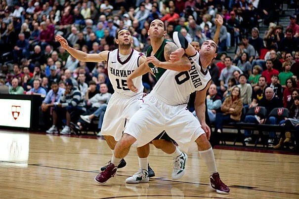 Harvard's Laurent Rivard (right) and Christian Webster (left) sandwich an opponent in pursuit of the rebound in a game against Dartmouth College on Jan. 7. The Crimson won 63-47.