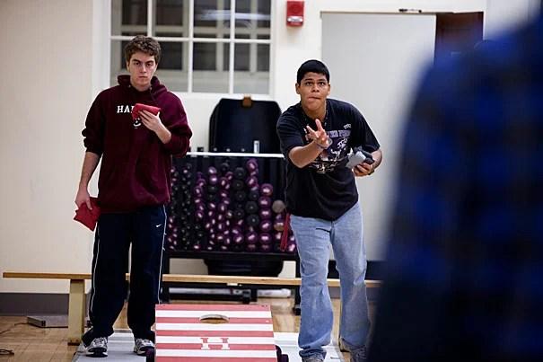 David Mazza '14 (left) and Juan Favela '14 toss around some beanbags at a Monday practice of Harvard's cornhole club.