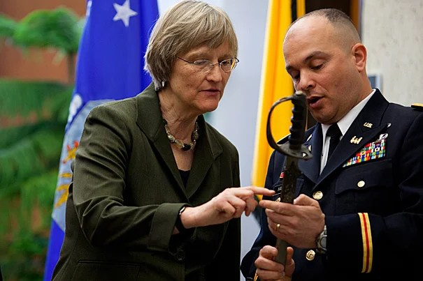 """""""To symbolize both our new beginning and our tradition"""" at Harvard, Army Lt. Col. Timothy J. Hall, commanding officer of the Paul Revere Battalion at MIT, showed Harvard President Drew Faust a saber that had been issued on May 30, 1916 to Capt. Constant Cordier, commander of the 1,000-student Harvard Regiment, precursor of the Army ROTC. The saber will be on display in the new Army ROTC office in Hilles, said Hall, where it resumes """"its rightful place at Harvard."""""""
