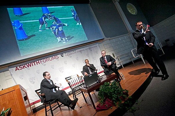 Askwith Forum panelists Andy Rotherham (from left), Domonique Foxworth, Tim Daly, and Brendan Daly discussed lessons for educators in the ways NFL teams prepare for games and evaluate talent.