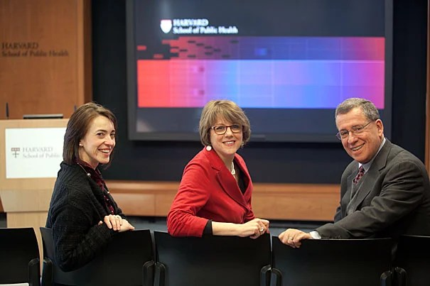 "The Harvard School of Public Health's ""Leadership Studio"" seats up to 40 and can host a variety of functions, from video conferences with multiple global participants, to faculty interviews for TV news shows, to the division's crown jewel, a regular webcast examining public health issues, The Forum at Harvard School of Public Health. Here, Miranda Daniloff Mancusi (from left), director of strategy and program development, Robin Herman, Forum director, and Richard L. Menschel Professor of Public Health Robert Blendon work together at the studio."