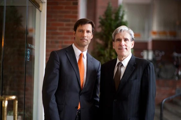 Mike VanRooyen (left) and Harvard School of Public Health Dean Julio Frenk were on hand to launch the Humanitarian Academy at Harvard. The program will be offered by the Harvard Humanitarian Initiative (HHI), an interfaculty effort that VanRooyen directs and that is focused on using research to improve aid response.