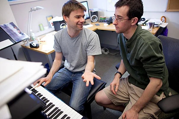 Harvard junior and musician Zach Sheets (right) has been working with composer and Radcliffe Fellow John Aylward, who is helping Sheets learn a new software for composition while giving him pointers for composing.
