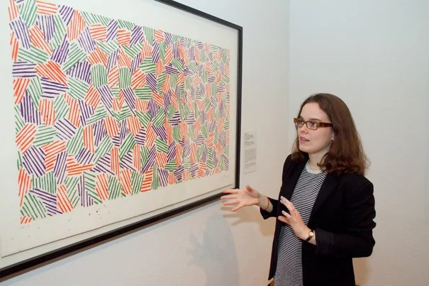 """Mary Potter '12, who helped create the new Harvard Art Museums exhibit on Jasper Johns, discusses his lithograph and woodcut """"Scent"""" (1976)."""