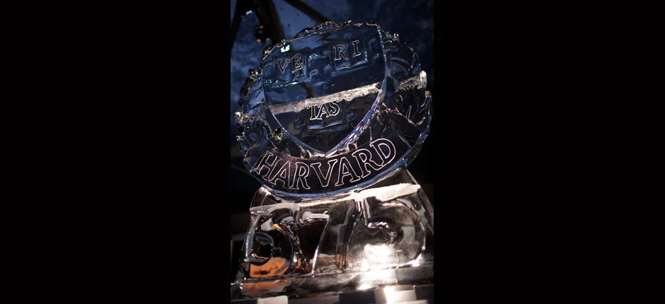 The veritas shield and 375 logo decorate an ice sculpture inside one of the tents in Tercentenary Theatre as Harvard celebrates its 375th year. Justin Ide/Harvard Staff Photographer