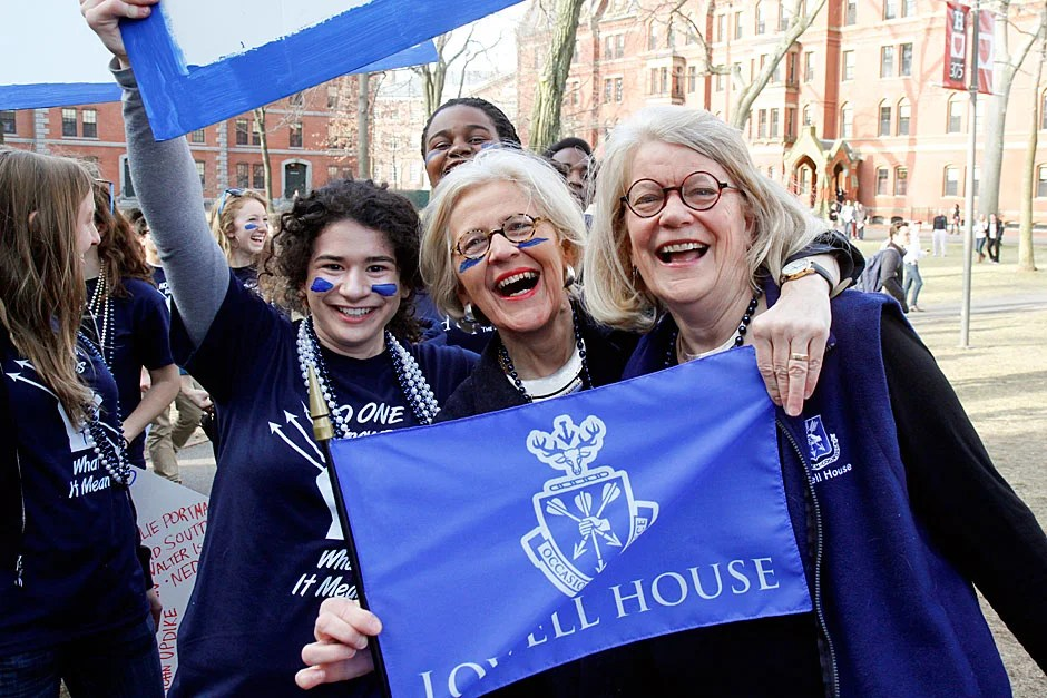 Lowell House Masters Dorothy Austin (center) and Diana Eck (right) are joined by Ellie Brinkley '13 as they display a House flag on Housing Day in Harvard Yard. Jon Chase/Harvard Staff Photographer