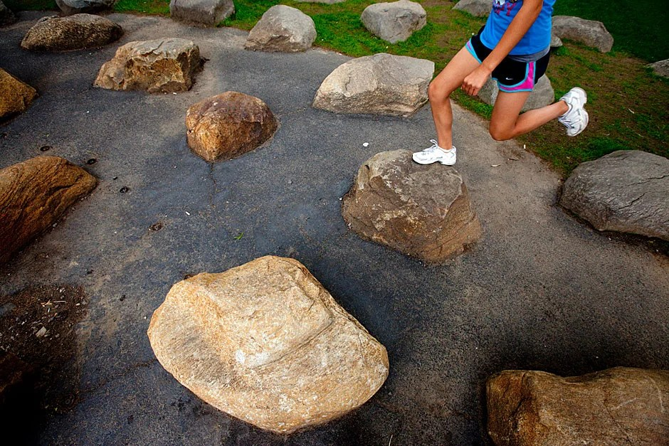 Circles of rocks outside the Science Center at Harvard are an irresistible place to jump. Rose Lincoln/Harvard Staff Photographer