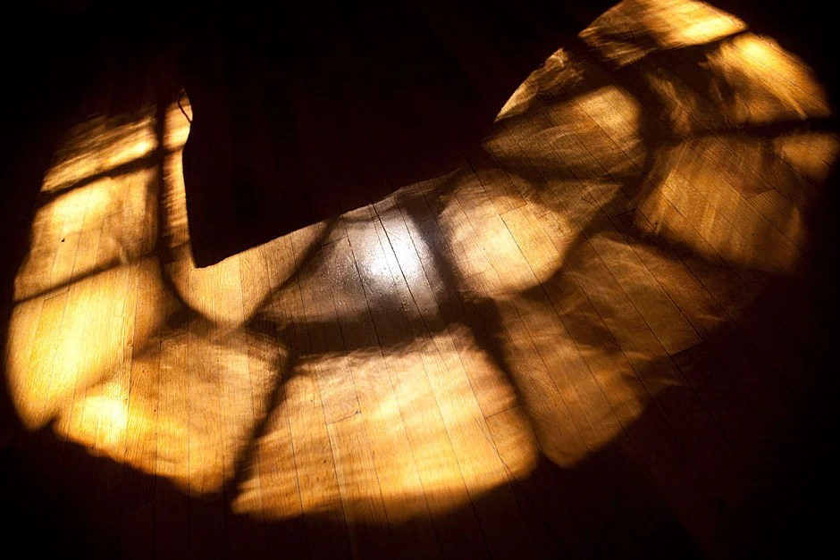 Sunny splotches reflected through a window encircle the base of a stairwell at the Memorial Church. Kris Snibbe/Harvard Staff Photographer