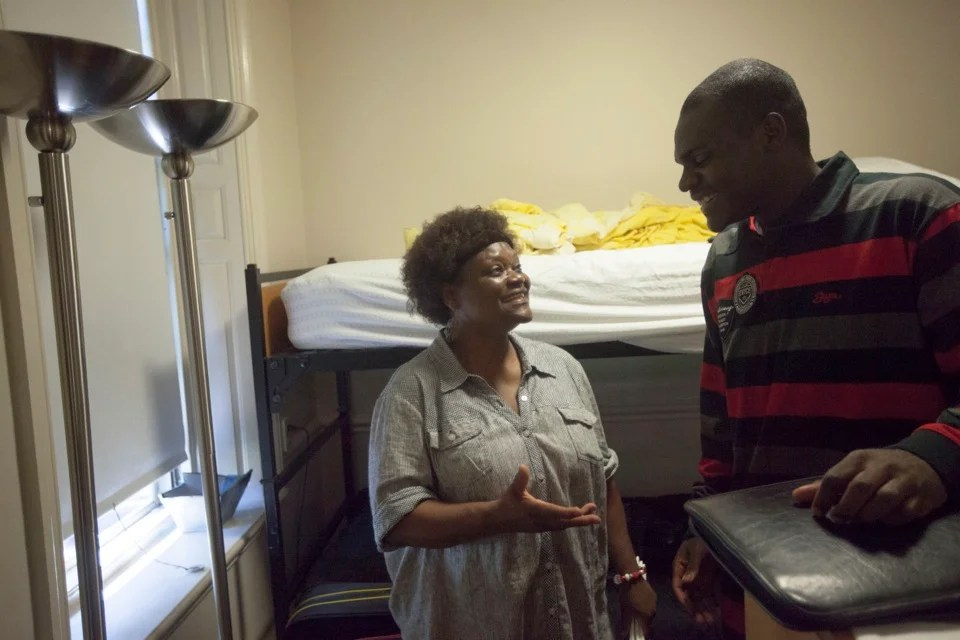 Esther Ojogho and son Dennis confer during Move-In Day.