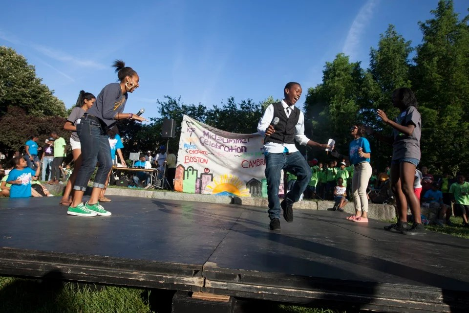 High school assistant teachers Aadreem Smith (left) and Willie Hobson showcase their dancing talents at the PBHA Midsummer Celebration.  Rose Lincoln/Harvard Staff Photographer